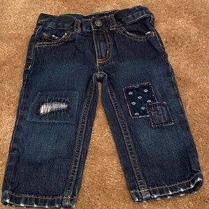 Dark blue jeans with patch